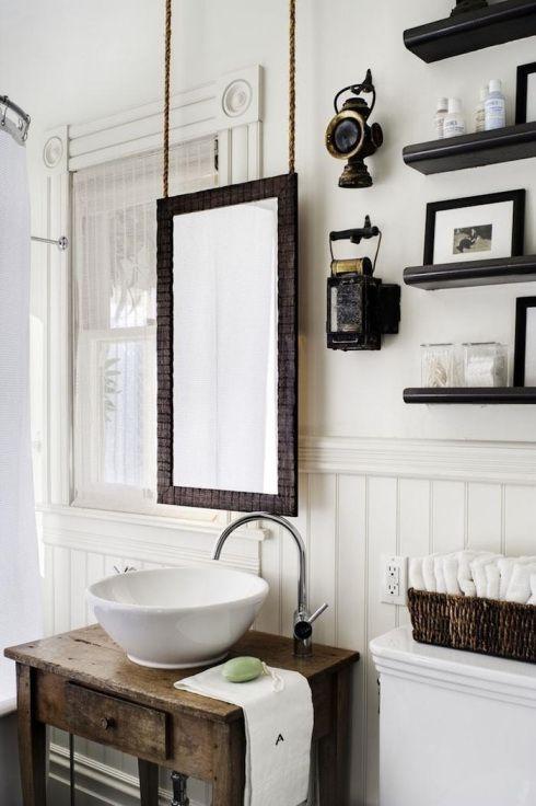 hang mirror in bathroom